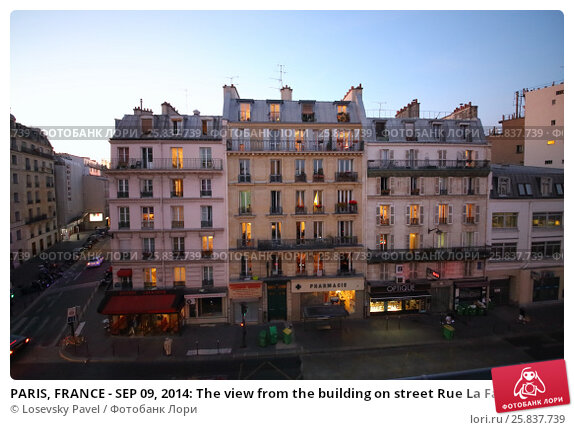 Купить «PARIS, FRANCE - SEP 09, 2014: The view from the building on street Rue La Fayette in Paris in the evening», фото № 25837739, снято 9 сентября 2014 г. (c) Losevsky Pavel / Фотобанк Лори