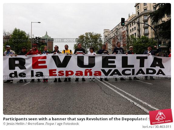 Participants seen with a banner that says Revolution of the Depopulated Spain. 'La Revuelta de la España Vaciada' from the Plaza de Colón in Madrid to... (2019 год). Редакционное фото, фотограф Jesús Hellín / age Fotostock / Фотобанк Лори