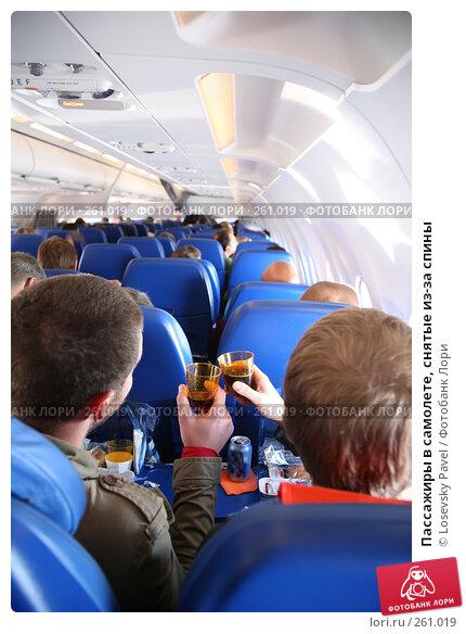 Купить «Пассажиры в самолете, снятые из-за спины», фото № 261019, снято 26 апреля 2018 г. (c) Losevsky Pavel / Фотобанк Лори