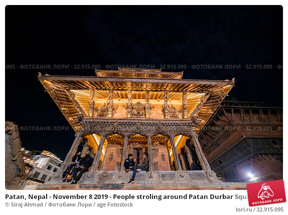 Patan, Nepal - November 8 2019 - People stroling around Patan Durbar Square at night. Редакционное фото, фотограф Siraj Ahmad / age Fotostock / Фотобанк Лори