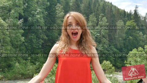 Купить «Patriotic holiday. Happy emotional woman with American flag on green forest background during summer day outdoors. USA celebrate 4th of July.», видеоролик № 30949159, снято 9 июня 2019 г. (c) Ольга Балынская / Фотобанк Лори