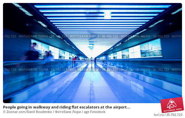 People going in walkway and riding flat escalators at the airport... Стоковое фото, фотограф Zoonar.com/Danil Roudenko / age Fotostock / Фотобанк Лори