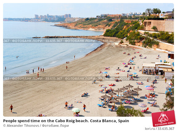 Купить «People spend time on the Cabo Roig beach. Costa Blanca, Spain», фото № 33635367, снято 13 марта 2020 г. (c) Alexander Tihonovs / Фотобанк Лори