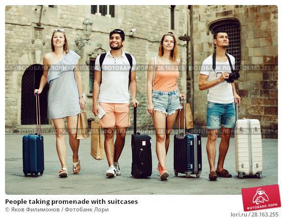Купить «People taking promenade with suitcases», фото № 28163255, снято 22 июня 2017 г. (c) Яков Филимонов / Фотобанк Лори