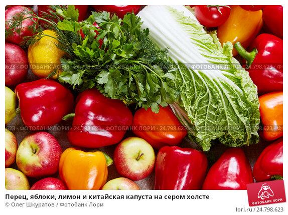 Перец, яблоки, лимон и китайская капуста на сером холсте, фото № 24798623, снято 3 мая 2016 г. (c) Олег Шкуратов / Фотобанк Лори