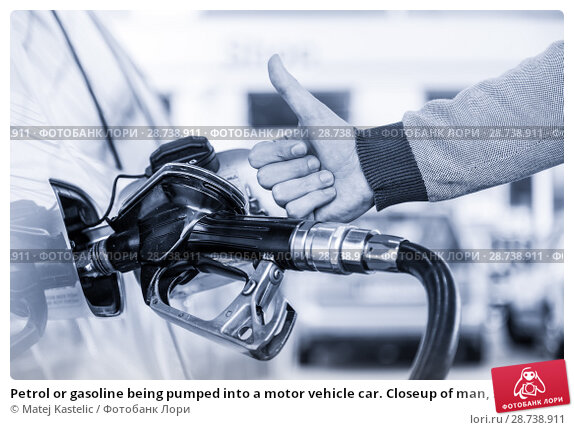 Купить «Petrol or gasoline being pumped into a motor vehicle car. Closeup of man, showing thumb up gesture, pumping gasoline fuel in car at gas station.», фото № 28738911, снято 30 апреля 2014 г. (c) Matej Kastelic / Фотобанк Лори