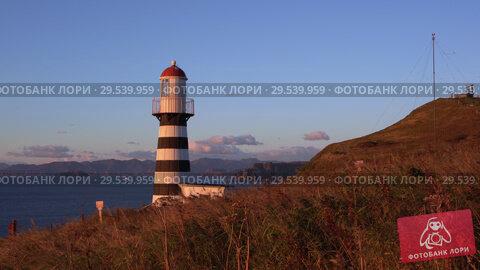 Купить «Petropavlovsk Lighthouse on Pacific Coast of Kamchatka Peninsula», видеоролик № 29539959, снято 15 октября 2018 г. (c) А. А. Пирагис / Фотобанк Лори