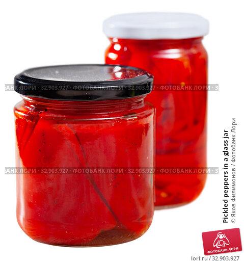 Купить «Pickled peppers in a glass jar», фото № 32903927, снято 9 апреля 2020 г. (c) Яков Филимонов / Фотобанк Лори