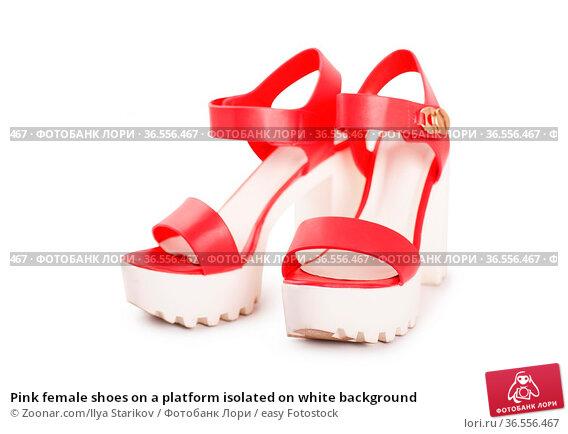 Pink female shoes on a platform isolated on white background. Стоковое фото, фотограф Zoonar.com/Ilya Starikov / easy Fotostock / Фотобанк Лори