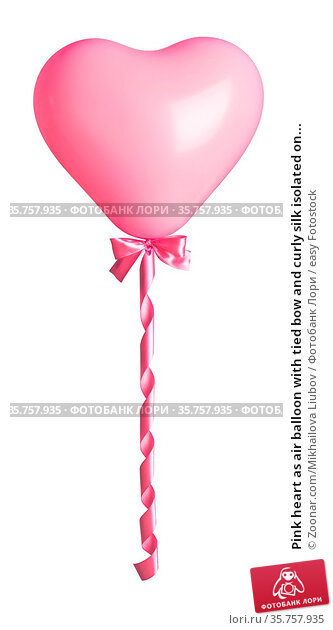 Pink heart as air balloon with tied bow and curly silk isolated on... Стоковое фото, фотограф Zoonar.com/Mikhailova Liubov / easy Fotostock / Фотобанк Лори