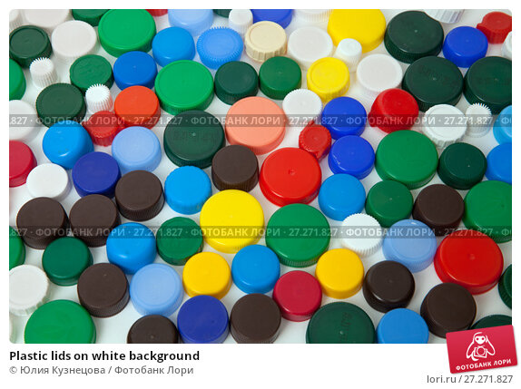 Купить «Plastic lids on white background», фото № 27271827, снято 3 декабря 2017 г. (c) Юлия Кузнецова / Фотобанк Лори