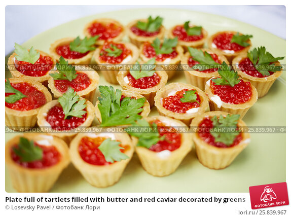 Купить «Plate full of tartlets filled with butter and red caviar decorated by greens», фото № 25839967, снято 30 мая 2015 г. (c) Losevsky Pavel / Фотобанк Лори