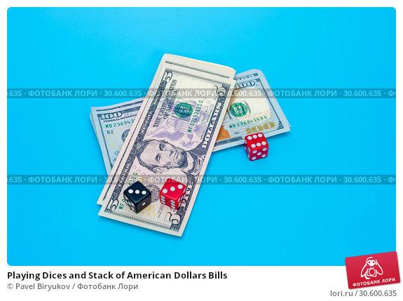 Купить «Playing Dices and Stack of American Dollars Bills», фото № 30600635, снято 23 мая 2019 г. (c) Pavel Biryukov / Фотобанк Лори