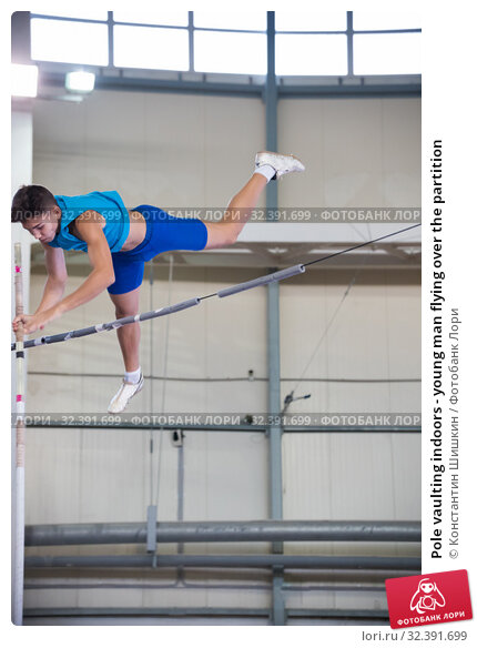 Купить «Pole vaulting indoors - young man flying over the partition», фото № 32391699, снято 1 ноября 2019 г. (c) Константин Шишкин / Фотобанк Лори