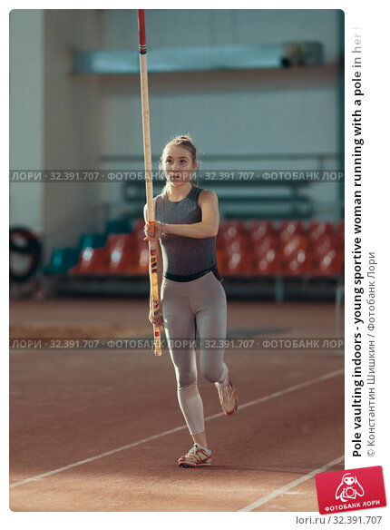 Купить «Pole vaulting indoors - young sportive woman running with a pole in her hands», фото № 32391707, снято 1 ноября 2019 г. (c) Константин Шишкин / Фотобанк Лори