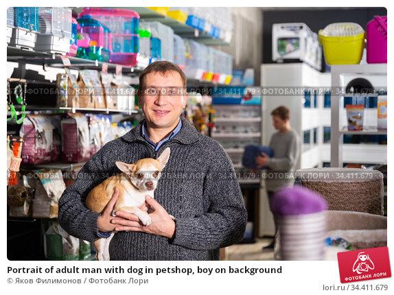 Portrait of adult man with dog in petshop, boy on background. Стоковое фото, фотограф Яков Филимонов / Фотобанк Лори