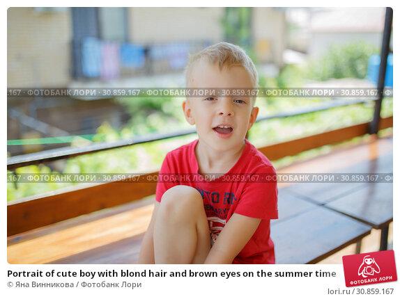 Купить «Portrait of cute boy with blond hair and brown eyes on the summer time», фото № 30859167, снято 1 июня 2019 г. (c) Яна Винникова / Фотобанк Лори