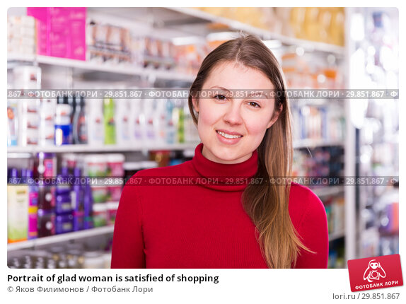 Купить «Portrait of glad woman is satisfied of shopping», фото № 29851867, снято 22 марта 2018 г. (c) Яков Филимонов / Фотобанк Лори