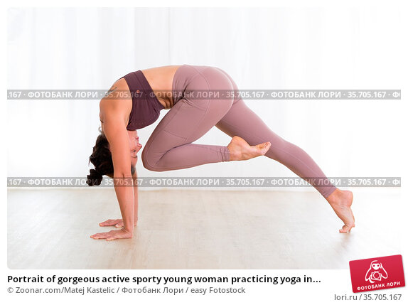 Portrait of gorgeous active sporty young woman practicing yoga in... Стоковое фото, фотограф Zoonar.com/Matej Kastelic / easy Fotostock / Фотобанк Лори
