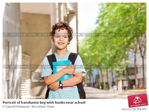 Купить «Portrait of handsome boy with books near school», фото № 26754971, снято 17 июня 2017 г. (c) Сергей Новиков / Фотобанк Лори