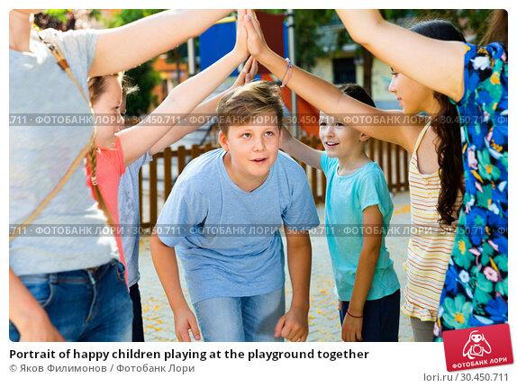 Portrait of happy children playing at the playground together. Стоковое фото, фотограф Яков Филимонов / Фотобанк Лори