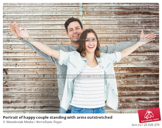 Купить «Portrait of happy couple standing with arms outstretched», фото № 25039379, снято 19 февраля 2019 г. (c) Wavebreak Media / Фотобанк Лори