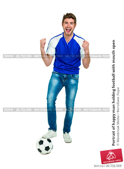 Купить «Portrait of happy man holding football with mouth open», фото № 20732559, снято 28 мая 2015 г. (c) Wavebreak Media / Фотобанк Лори