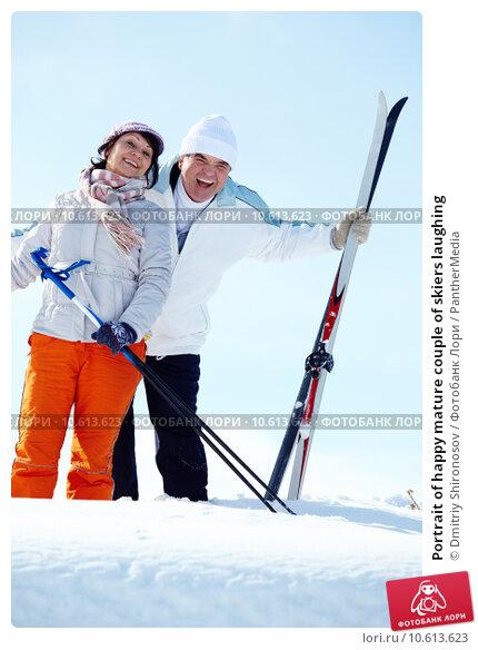 Portrait of happy mature couple of skiers laughing. Стоковое фото, фотограф Dmitriy Shironosov / PantherMedia / Фотобанк Лори