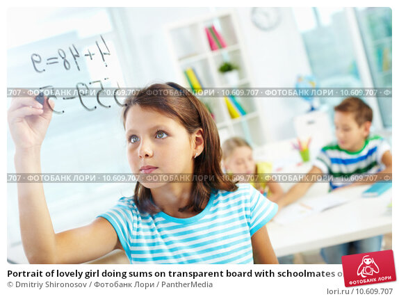 Portrait of lovely girl doing sums on transparent board with schoolmates on background. Стоковое фото, фотограф Dmitriy Shironosov / PantherMedia / Фотобанк Лори