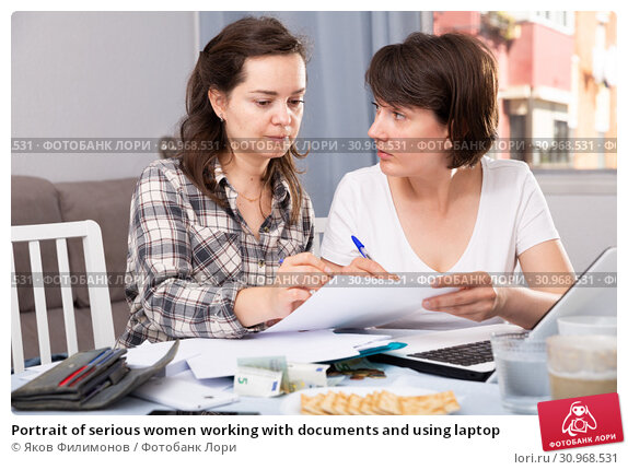 Купить «Portrait of serious women working with documents and using laptop», фото № 30968531, снято 20 июля 2019 г. (c) Яков Филимонов / Фотобанк Лори