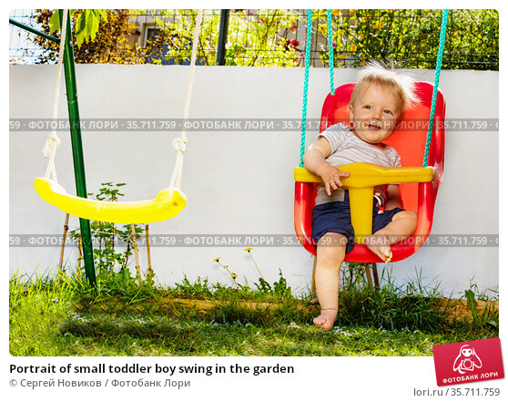 Portrait of small toddler boy swing in the garden. Стоковое фото, фотограф Сергей Новиков / Фотобанк Лори