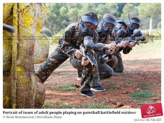 Купить «Portrait of team of adult people playing on paintball battlefield outdoor», фото № 30726427, снято 22 сентября 2018 г. (c) Яков Филимонов / Фотобанк Лори