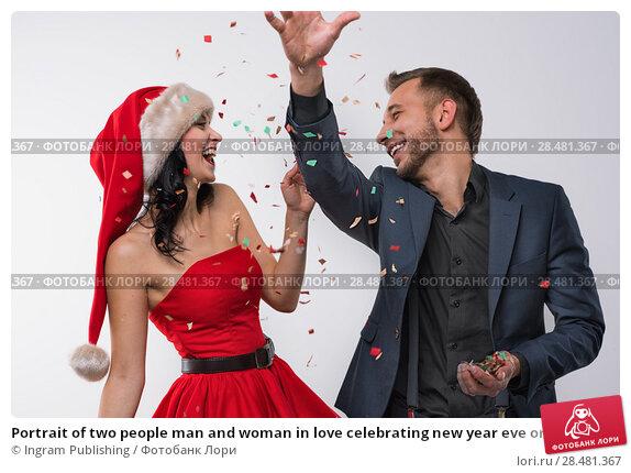 Купить «Portrait of two people man and woman in love celebrating new year eve or christmas party», фото № 28481367, снято 15 октября 2014 г. (c) Ingram Publishing / Фотобанк Лори