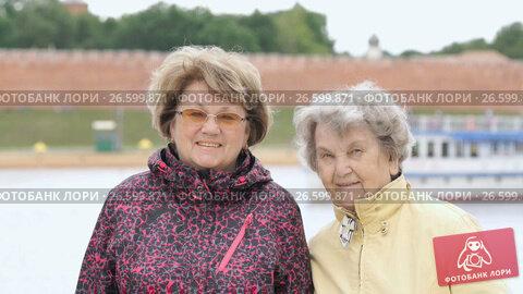 Купить «Portrait of two smiling adult women outdoors», видеоролик № 26599871, снято 30 июня 2017 г. (c) worker / Фотобанк Лори
