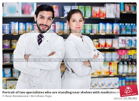 Купить «Portrait of two specialistes who are standing near shelves with medicines in pharmacy.», фото № 29396903, снято 28 февраля 2018 г. (c) Яков Филимонов / Фотобанк Лори