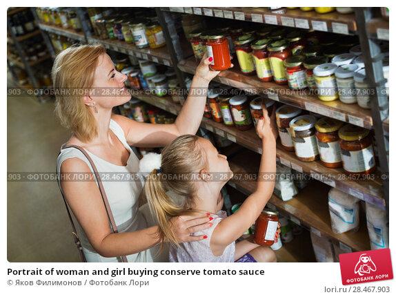 Купить «Portrait of woman and girl buying conserve tomato sauce», фото № 28467903, снято 22 сентября 2018 г. (c) Яков Филимонов / Фотобанк Лори