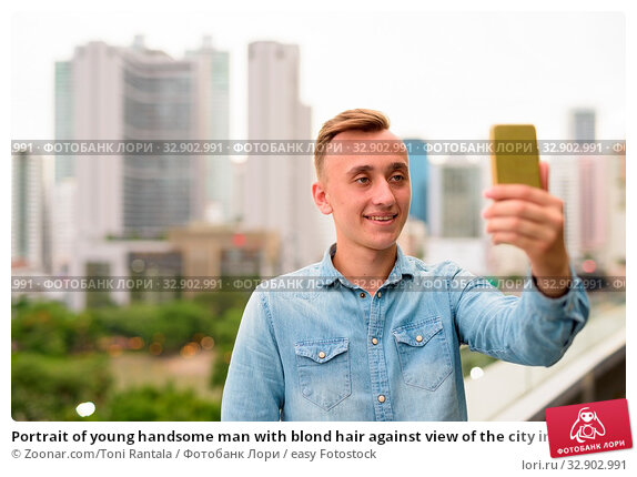 Portrait of young handsome man with blond hair against view of the city in Bangkok, Thailand. Стоковое фото, фотограф Zoonar.com/Toni Rantala / easy Fotostock / Фотобанк Лори