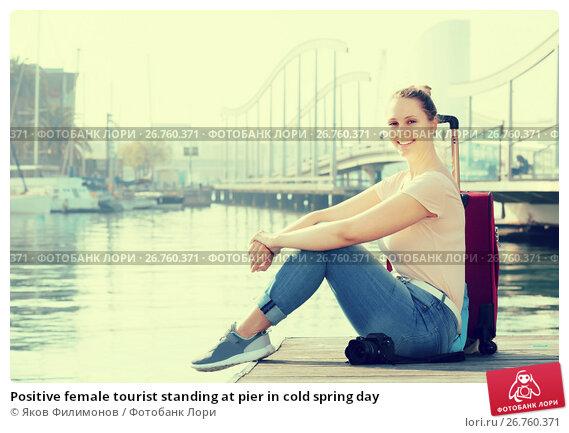 Купить «Positive female tourist standing at pier in cold spring day», фото № 26760371, снято 4 мая 2017 г. (c) Яков Филимонов / Фотобанк Лори