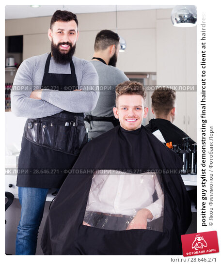 Купить «positive guy stylist demonstrating final haircut to client at hairdressing salon», фото № 28646271, снято 27 января 2017 г. (c) Яков Филимонов / Фотобанк Лори