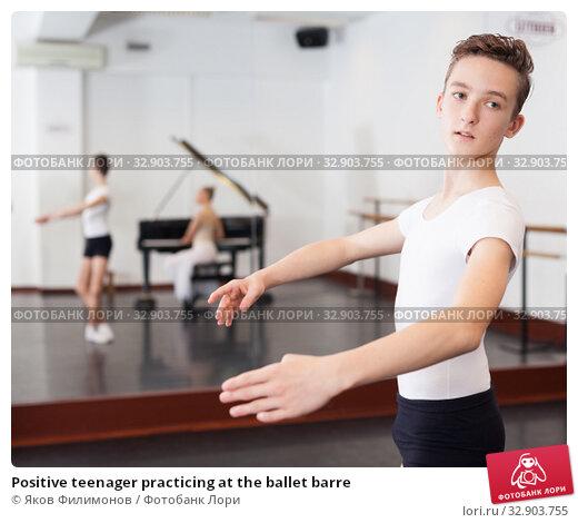 Positive teenager practicing at the ballet barre. Стоковое фото, фотограф Яков Филимонов / Фотобанк Лори