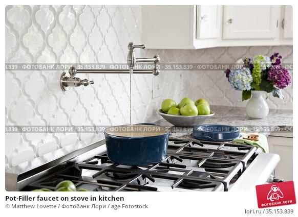 Pot-Filler faucet on stove in kitchen. Стоковое фото, фотограф Matthew Lovette / age Fotostock / Фотобанк Лори