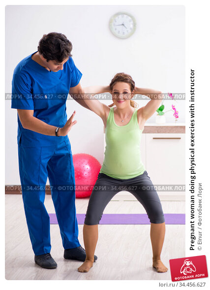 Pregnant woman doing physical exercies with instructor. Стоковое фото, фотограф Elnur / Фотобанк Лори