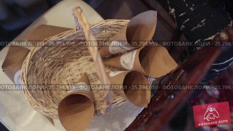 Preparing bags with petals, видеоролик № 25794939, снято 2 марта 2016 г. (c) Алексей Макаров / Фотобанк Лори