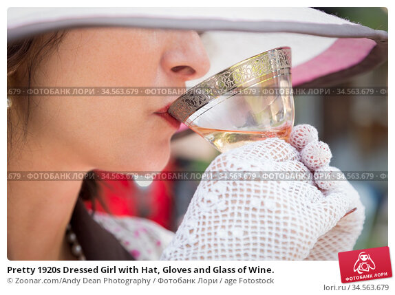 Pretty 1920s Dressed Girl with Hat, Gloves and Glass of Wine. Стоковое фото, фотограф Zoonar.com/Andy Dean Photography / age Fotostock / Фотобанк Лори