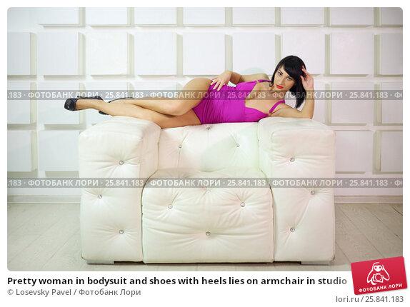 Купить «Pretty woman in bodysuit and shoes with heels lies on armchair in studio», фото № 25841183, снято 4 июня 2015 г. (c) Losevsky Pavel / Фотобанк Лори