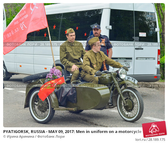 PYATIGORSK, RUSSIA - MAY 09, 2017: Men in uniform on a motorcycle M-72 with a cradle. Редакционное фото, фотограф Ирина Аринина / Фотобанк Лори