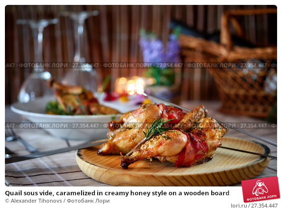 Купить «Quail sous vide, caramelized in creamy honey style on a wooden board», фото № 27354447, снято 21 декабря 2017 г. (c) Alexander Tihonovs / Фотобанк Лори