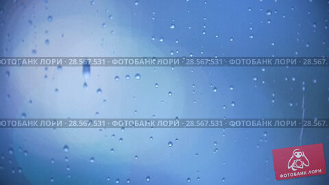 Купить «Rain drops on the window glass - blue tone», видеоролик № 28567531, снято 21 августа 2018 г. (c) Константин Шишкин / Фотобанк Лори