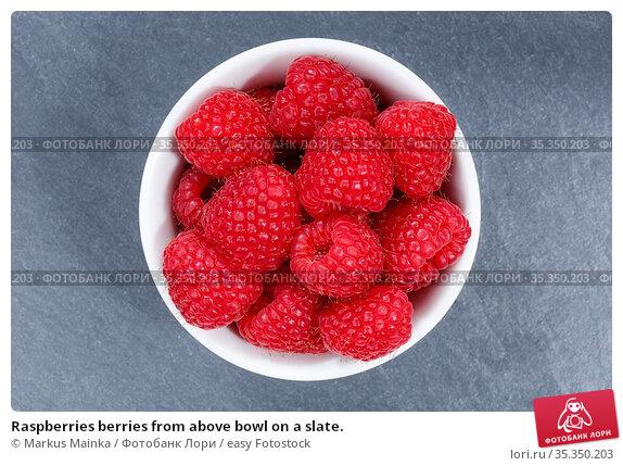 Raspberries berries from above bowl on a slate. Стоковое фото, фотограф Markus Mainka / easy Fotostock / Фотобанк Лори