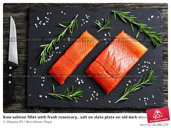 Купить «Raw salmon fillet with fresh rosemary,. salt on slate plate on old dark wooden table with knife, view from above, close-up», фото № 26888279, снято 9 февраля 2017 г. (c) Oksana Zh / Фотобанк Лори